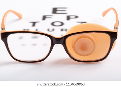 Ortopad Eye Patches flesh-colored eyeglasses for the treatment of strabismus (lazy eye) Occluders Press lenses and side shields Eye Test Chart Vector Vision Exam Optometrist Check Medical Eye