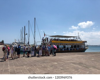 ORTYGIA, SCYRACUSE, SICILY, ITALY - MAY 24, 2018 - TOURISTS QUEUING FOR BOAT TRIP