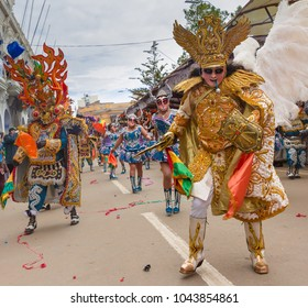 Oruro, Bolivia, February 2018: Carnival dancers procession with colorful traditional costumes on the decorated streets of Oruro in Bolivia, UNESCO heritage tradition