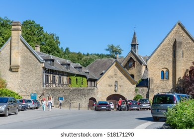 ORVAL, BELGIUM - AUGUST 23, 2016: Entrance famous Orval Abbey in Belgian Ardennes. The abbey is famous for its trappist beer, botanical garden and ruins