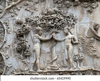 orvieto - Duomo facade. The first pillar: scenes from Genesis.Eve offers the forbidden fruit to Adam.