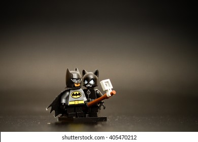 Orvieto, Italy - April 13th 2016: Batman an Cat Woman Lego take a selfie. Lego is a popular line of construction toys manufactured by the Lego Group.