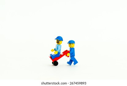 Orvieto, Italy - April 5th 2015: Couple of Lego minifigures friends. Lego is a popular line of construction toys manufactured by the Lego Group