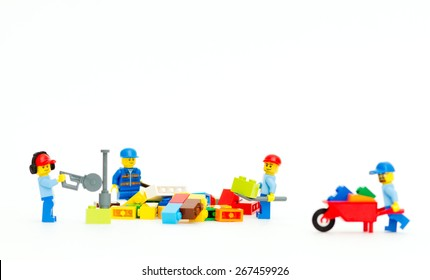 Orvieto, Italy - April 5th 2015: Lego mini figure workman at work on white background. Lego is a popular line of construction toys manufactured by the Lego Group