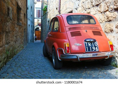Orvieto, Italy - August 19, 2018: Old Fiat 500 in narrow alley of Orvieto