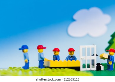 Orvieto, Italy - August 29th 2015: Construction site of Lego, Team of workmen build a house in a sunny day. Lego is a popular line of construction toys manufactured by the Lego Group