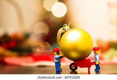 Orvieto, Italy - December  06th 2015: Couple of Lego worker minifigures take a gift for christmas.