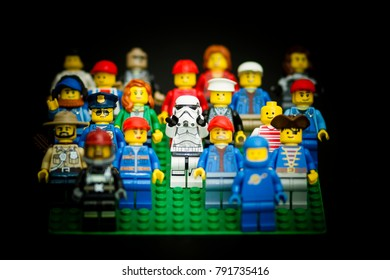 Orvieto, Italy - February  08th 2016:  Star Wars Lego Stormtroopers minifigure in a group of people. Focus on Stormtroopers.  Lego is a popular line of construction toys manufactured by the Lego Group