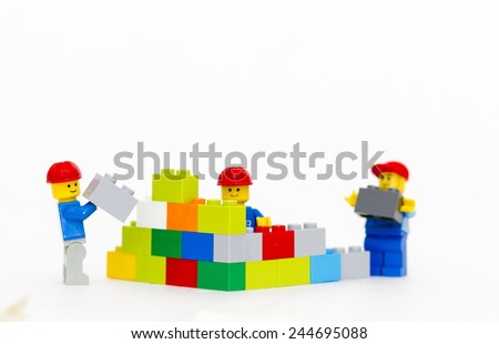 Orvieto, Italy - January 16th 2015: team of workman Lego mini figure build a wall. Lego is a popular line of construction toys manufactured by the Lego Group