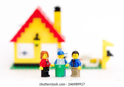 Orvieto, Italy - January 25th 2015: Lego mini figures family recycling domestic waste. Lego is a popular line of construction toys manufactured by the Lego Group