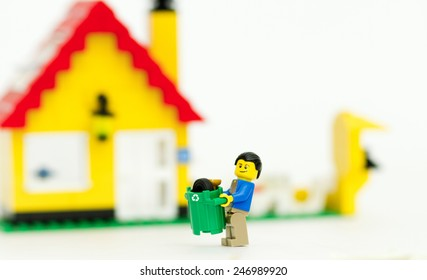 Orvieto, Italy - January 25th 2015: Lego mini figure Worker of urban municipal recycling garbage collector. Lego is a popular line of construction toys manufactured by the Lego Group