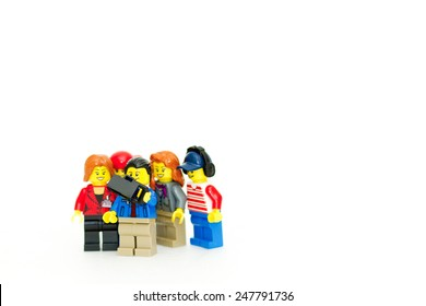 Orvieto, Italy - January 28th 2015: Multiethnic Group of Friends Lego mini figure Taking Selfie  build. Lego is a popular line of construction toys manufactured by the Lego Group