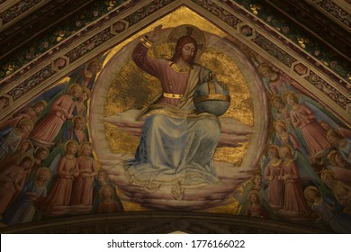 Orvieto, Italy - Jul 12, 2020: Renaissance Fresco of Christ in Judgment, His Right Hand Raised in Blessing and his Left Hand Holding an Orb Surrounded by Ecstatic Angels at Orvieto Cathedral