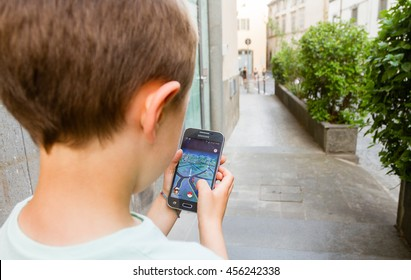 Orvieto, Italy - July 21th 2016: Child playing Pokemon Go on his smpartphone. Walking and playing