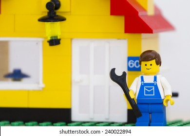 Orvieto, Italy - July 23th 2014: Lego mini figure workman at work in a house. Lego is a popular line of construction toys manufactured by the Lego Group