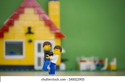 Orvieto, Italy - July 23th 2014: Lego mini figure gay man embrace in front of their house. Lego is a popular line of construction toys manufactured by the Lego Group