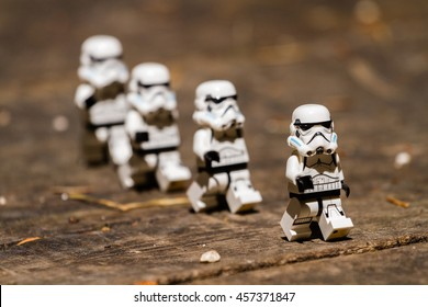 Orvieto, Italy - July 24th 2015: Group o Star Wars Lego Stormtroopers walking on a wood floor. Lego is a popular line of construction toys