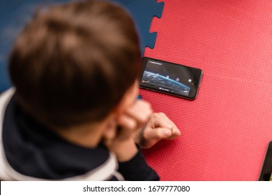 Orvieto, Italy, March 19 2020: Child watching film on Netflix streaming service.