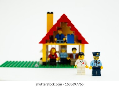 Orvieto, Italy - March 19th 2020: Lego family in quarantine due to covid-19. Focus on doctor and police man