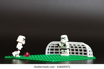 Orvieto, Italy - May 11th 2016: Group o Star Wars Lego Stormtroopers mini figures playing soccer. Lego is a popular line of construction toys manufactured by the Lego Group