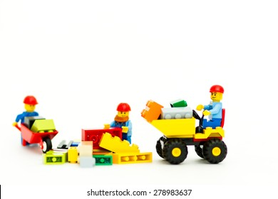 Orvieto, Italy - May 18th 2015: team of workman Lego mini figure build a wall. Lego is a popular line of construction toys manufactured by the Lego Group