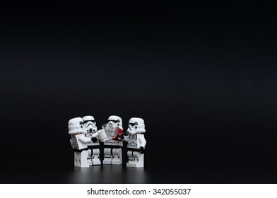Orvieto, Italy - November 15th 2015: Group of Star Wars Lego Stormtroopers mini figures drunk a beer. Lego is a popular line of construction toys manufactured by the Lego Group