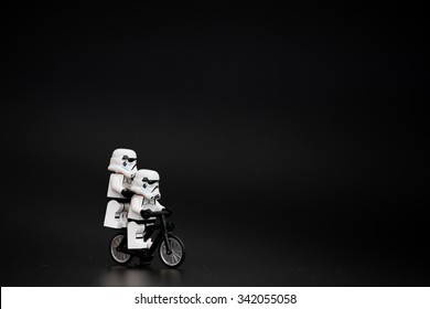 Orvieto, Italy - November 15th 2015: Star Wars Lego Stormtroopers mini figures on bicycle. Lego is a popular line of construction toys manufactured by the Lego Group