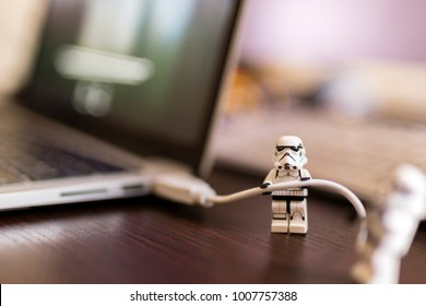Orvieto, Italy - November 15th 2017: Star Wars Lego Stormtrooper minifigures and usb cable near a laptop