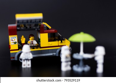 Orvieto, Italy - November 15th 2017:. Lego Hawker on food truck and Ster wars Stormtroopers minifigure . Street food concept.
