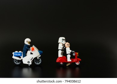 Orvieto, Italy - November 15th 2017: Star Wars Lego Stormtroopers on Vespa escape to police