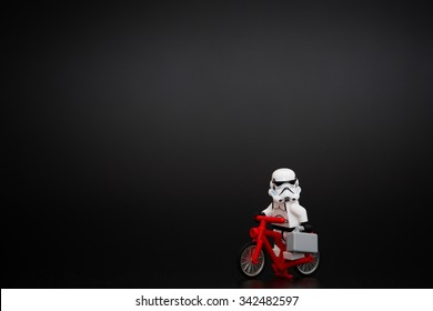 Orvieto, Italy - November 22th 2015: Group of Star Wars Lego Stormtroopers minifigures on bicycle.  Lego is a popular line of construction toys manufactured by the Lego Group