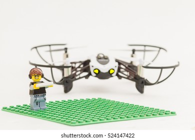 Orvieto, Italy - November 27th 2016: Lego minifigure playing with a drone.