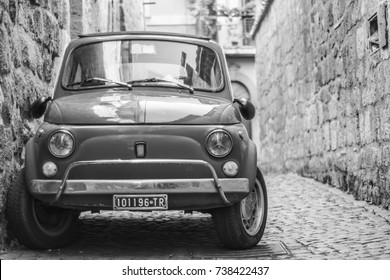 Orvieto, Italy - October 2017 - Fiat 500 parked in the street, black & white