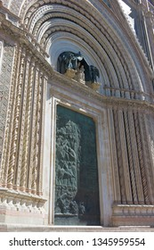 ORVIETO, ITALY - SEPTEMBER 14 2013 - Richly decorated door and entrance of the Duomo Cathedral of Orvieto in Italy
