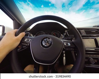 Orvieto, Italy - September 23th 2015: Man driving a Volkswagen Golf 1.6 Tdi, POV original point of view.