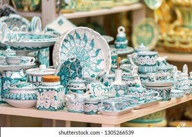 Orvieto, Italy - September 3, 2018: Souvenir shopping in small Italian town city with street vendor and blue ceramic plates at retail display nobody