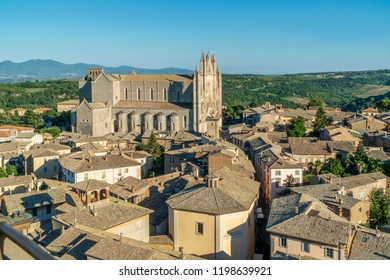 Orvieto, Italy Umbria. View on historic Duomo di Orvieto, Orvieto Cathedral from the Torre del Moro tower. Overlooking Orvieto heritage.