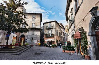 Orvieto, Umbria, Italy, narrow street with small shops
