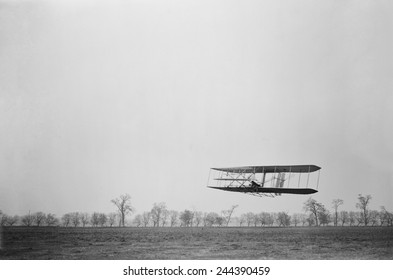 Orville Wright 1871-1948 in flight over treetops covering a distance of approximately 1 760 feet in 40 1/5 seconds at Huffman Prairie Dayton Ohio. November 16 1904.