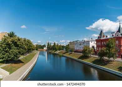 Oryol or Orel city embankment in summer day, Russia. Oka river and historic and religious buildings