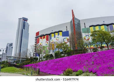Osaka, APR 29: Cosmo Tower and ATC Shopping Mall with purple flowers blossom on APR 29, 2011 at Osaka, Japan