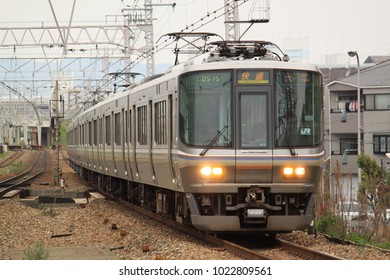 Osaka - April 5, 2014: The rapid train running at the suburban area on the cloudy day in April 5, 2014 Osaka, Japan.