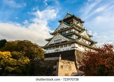 Osaka Castle in Osaka with autumn leaves. Japan.