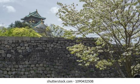 Osaka castle behind the wall