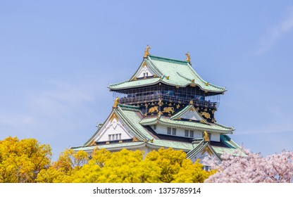Osaka castle with blurred cherry blossom foregrounds. Japanese spring beautiful scene in Japan