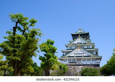 Osaka Castle and green trees.