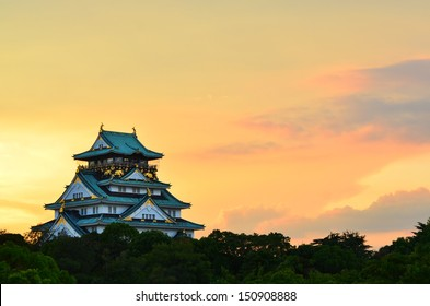 Osaka Castle in Osaka, Japan during a colorful pastel summer sunset.
