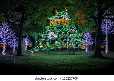 """Osaka Castle night illumination, Osaka, Japan - November 2017 : """"Osaka-jo Castle Illuminage"""" the greatest light show in osaka (with some noise on photo)"""