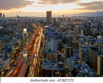 Osaka city highway and illuminated car trails and building
