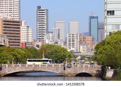 Osaka city, Japan. Cityscape with historic Yodoyabashi bridge.